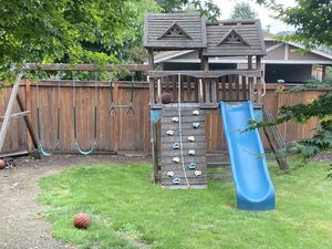 Costco Swing Set Play Set Will need new swings/monkey bar for Sale in Tacoma, WA