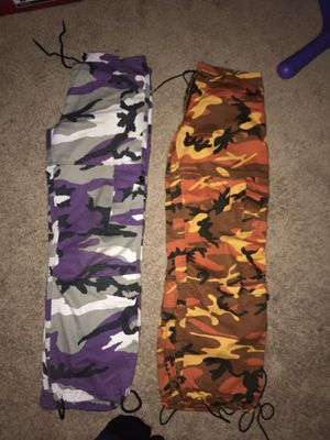 Both orange and purple camo pants ROTHCO brand from zumies for Sale in Bothell, WA