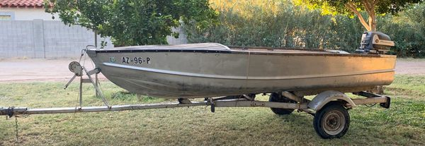 Aluminum Boat & Trailer with Evinrude Motor