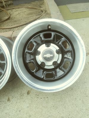 5 Chevy 15inch Rally rims w/rings caps for Sale in Santa Fe Springs, CA