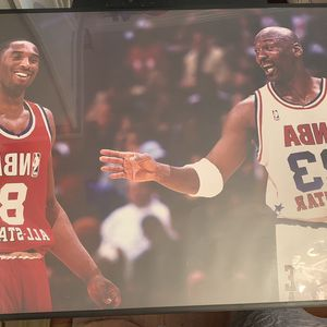 Kobe Bryant and Michael Jordan poster with frame. for Sale in West Covina, CA