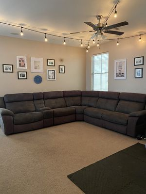 RC Willey electric sectional couch with 3 recliners and charging console for Sale in Henderson, NV