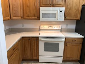 Laminate countertop and dishwasher, electric range and microwave for Sale in The Villages, FL