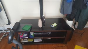 Used tv stand in good shape holds flat screen tv's and theater systems. for Sale in Washington, DC