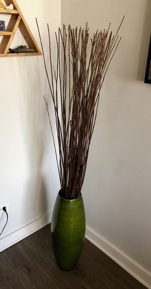 Large green floor vase with decorative wooden sticks for Sale in Chicago, IL