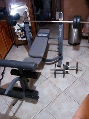 Weight bench with 50 pounds and dumbbells for Sale in Phoenix, AZ
