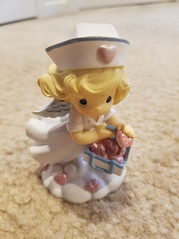Precious Moments ceramic nurse figurine