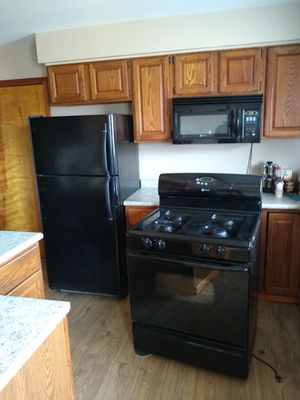 Maytag 's refrigerator , gas range and microwave for Sale in Albion, MI