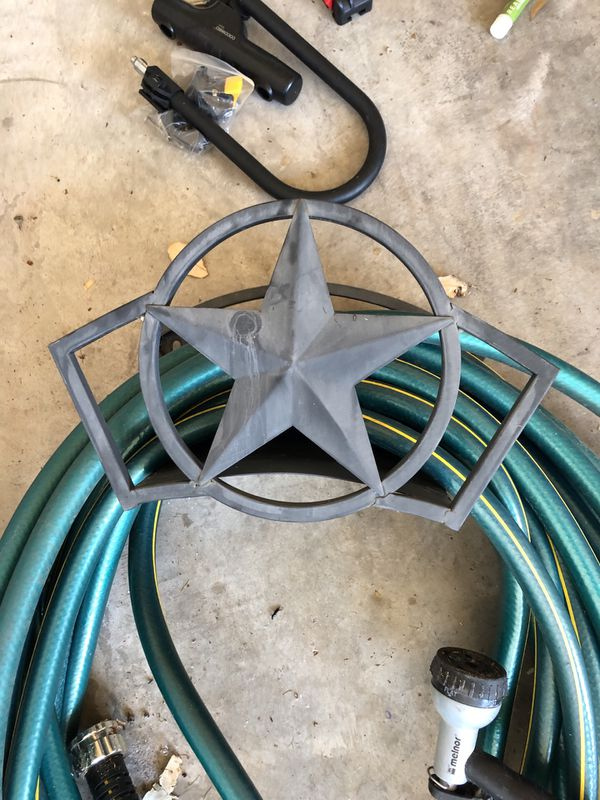 Hose, attached nozzle and star holder