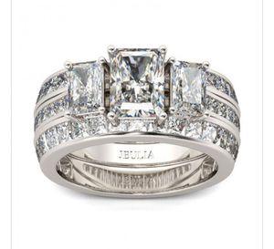 Jeulia 3PC Three Stone Radiant Cut Created White Sapphire Women's Wedding Set 3.2CT for Sale in Phoenix, AZ