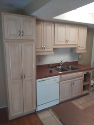 Like new kitchen cabinets stove and hanging microwave for Sale in St. Petersburg, FL
