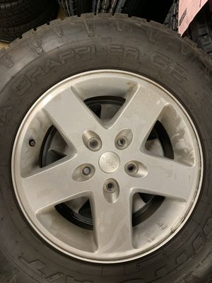 5-Jeep Wrangler wheels and tires 4-265/70-17 nittos. 5 wheels with stock spare $250 for Sale in Glendora, CA