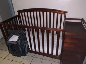 Crib with mattress changing table and drawer and diaper/accessories holder for Sale in Homestead, FL