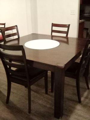 Dining table with built in lazy Susan seats 8 people comes with 4 chairs for Sale in Fresno, CA