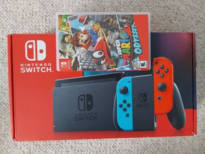BRAND NEW Nintendo Switch newest version Blue Red Joy-Cons System w/ Super Mario Odyssey for Sale in Denver, CO