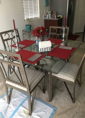 Dining table four chairs and glass shelved wine rack included for Sale in Las Vegas, NV