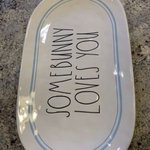 """NEW! RAE DUNN EASTER PLATTER . """"SOMEBUNNY LOVES YOU"""". 2018 RELEASE, Classic LL Font. Oval platter with BLUE Stripes. SEE PHOTOS for Sale in Naperville, IL"""