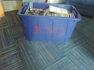 Tote of new and older dvds for Sale in Lookout, WV
