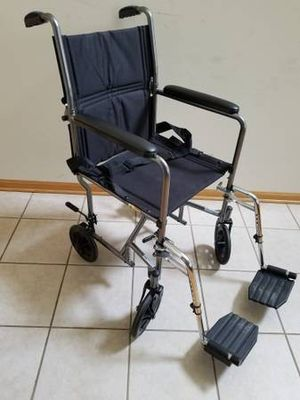 Transport wheelchair with foot rest-$90 for Sale in Roselle, IL