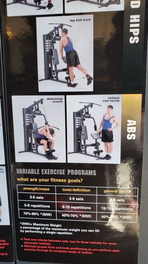 Workout bench with weights for Sale in Portland, OR