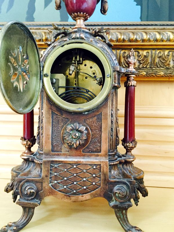 Gorgeous French clock with 2 candelabras. The French Antique Ormolu clock with a pair of candelabras and original sniffers signed by artist Carl 3130