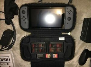 Preowned but mint gray Nintendo switch console with all components & 11 Games for Sale in Nashville, TN