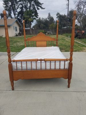 Solid wood oak queen size poster bed for Sale in Selma, CA