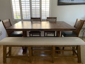 Table with 2 expansion leaves, 4 chairs and padded bench for Sale in San Diego, CA