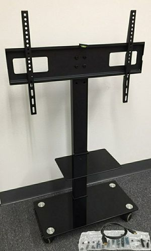 Brand new in box TV stand on wheels universal fits 32 to 65 Inch TV sizes flat screen LCD plasma with glass shelf for Sale in Whittier, CA