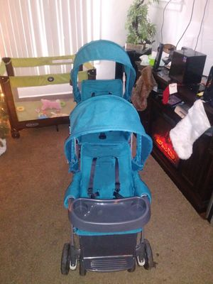 The big caboose double stroller by joovy for Sale in Detroit, MI