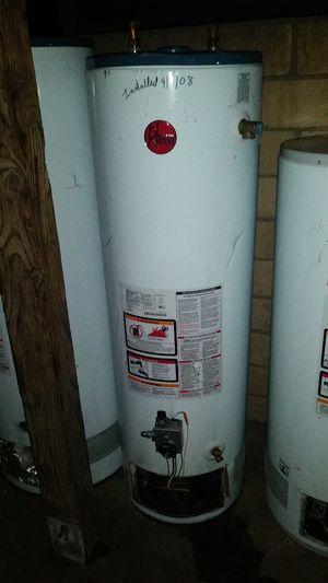 Water heater Rheem. System 30 galones gas warranty for Sale in Bloomington, CA