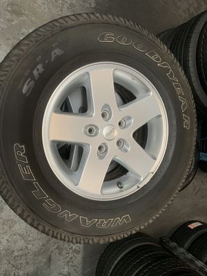 Jeep Wrangler wheels and tires Cheap rims 255/75/17 goodyears for Sale in Sugar Hill, GA