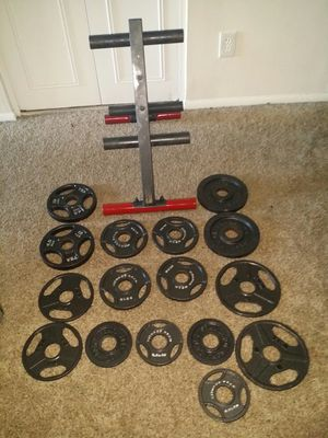 """Body solid Olympic weight tree with 85lbs 2"""" weights. 4x10lbs, 6x5lbs, 6x2.5lbs. for Sale in Deerfield Beach, FL"""