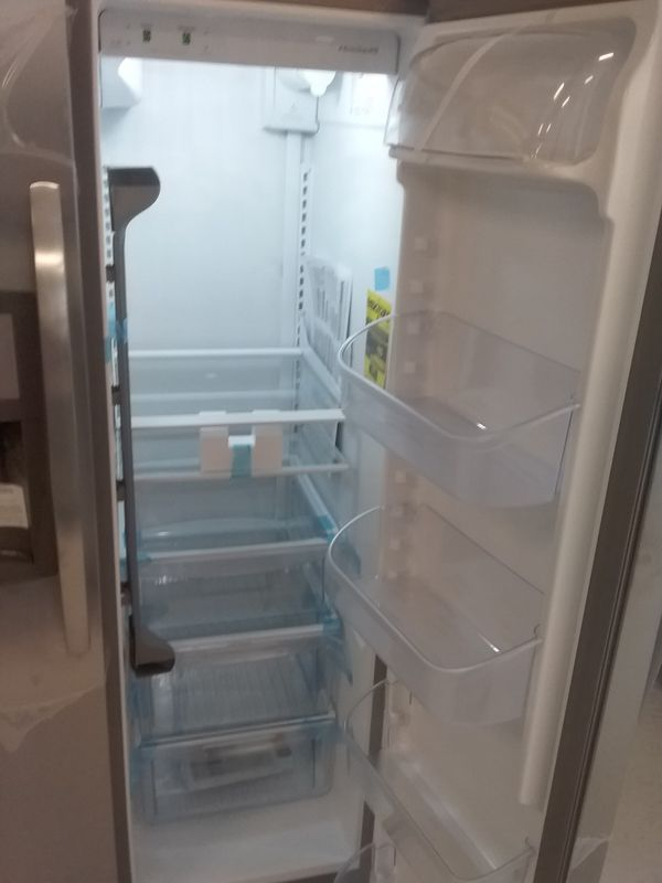 Frigidaire side by side stainless steel refrigerator new scratch and dents good condition 6 months warranty
