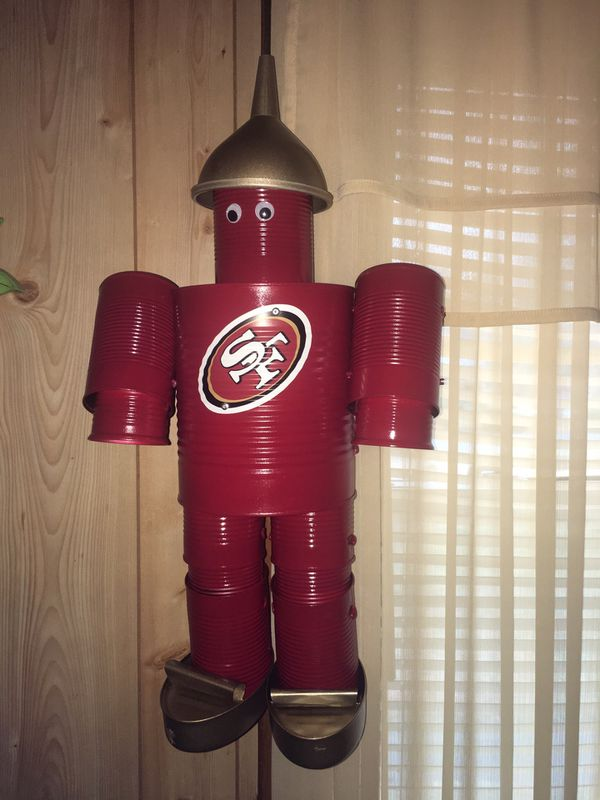Tin man (home made) hang on your porch $25 for ones without sports logo