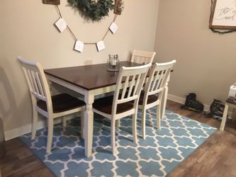 Brown/off white Distressed dinning table bought brand new from Ashley Homestore a year ago. for Sale in Renton,  WA
