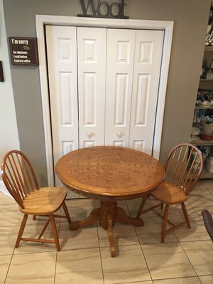 """Solid oak table and 2 chairs. Used in good condition. Table size 42"""" x 42"""" x 29"""" for Sale in Mooresville, NC"""