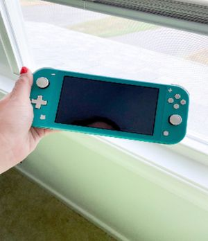Nintendo Switch Lite Turquoise BUNDLE for Sale in Boon, MI
