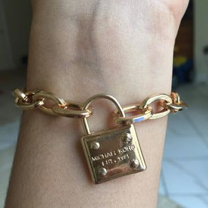 Mk Michael kors padlock gold tone bracelet for Sale in Silver Spring, MD