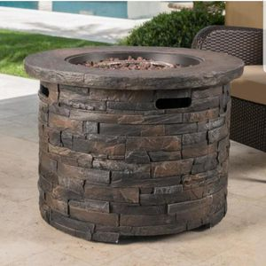 Noble House Blaeberry 34.5 in. x 24 in. Natural Stone Circular Gas Outdoor Firepit for Sale in Miami, FL