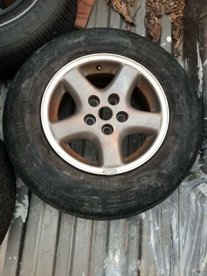 Tires go on a Jeep Cherokee comes with 5 rims with tires somewhere good some bad, and a good for f 150 red for Sale in Fort Worth, TX