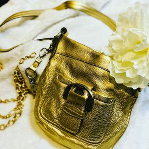B Makowsky gold leather crossbody bag. Heavy metal accents. for Sale in Miami, FL