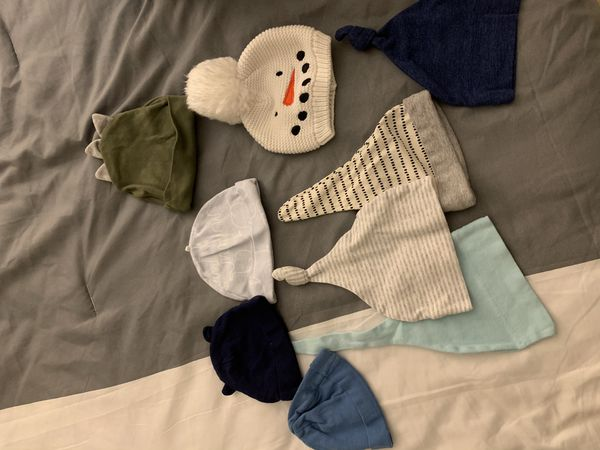 Baby clothes, hats, maternity clothes, and unopened newborn baby diapers.