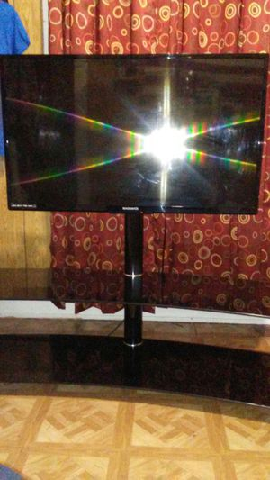Black Glass TV Stand.23 to 55 inch tv wall Bracket Flat. only table not the tv for Sale in Cleveland, OH
