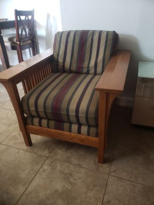 Nice and clean padded chair with big wooden armrest. for Sale in Las Vegas, NV