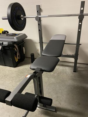 Standard weight bench bar and bumper plates for Sale in Tacoma, WA
