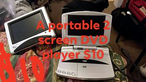 A portable duel screen DVD player .good for home or on the go. for Sale in Mineral Wells, WV