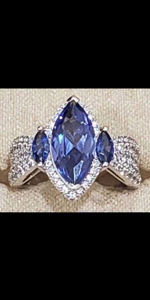 Brand New Bella Luce 6.60ctw Marquise Tanzanite Simulant Round Diamond Simulant .925 Sterling Silver Ring. Size 6. for Sale in Mesa, AZ
