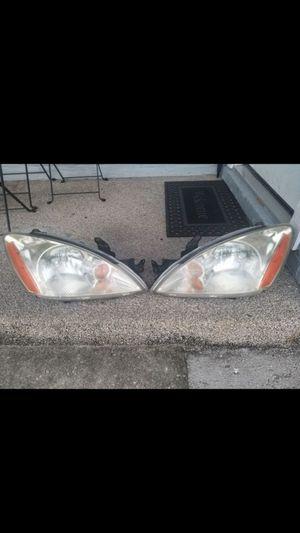 Headlight for Mitsubishi lancer 2004 for Sale in Lakeland, FL