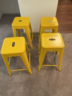Set of 4 yellow metal stools for Sale in Austin, TX